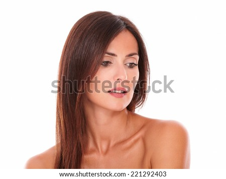 Head and shoulders portrait of young latin woman showing her sensual look on isolated studio