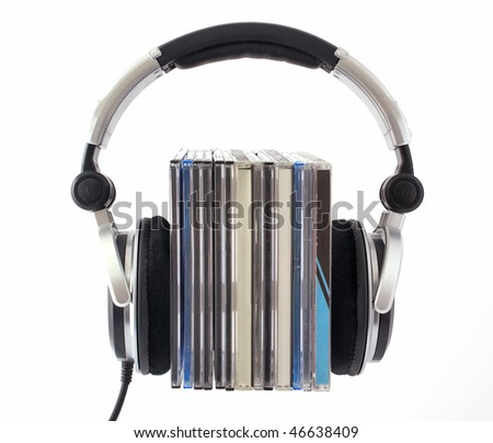 Headphones with CD boxes on white background