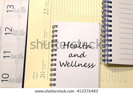 Health and wellness text concept write on notebook