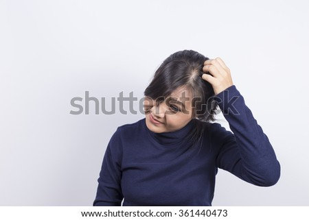 Health Care: Woman scratching her head