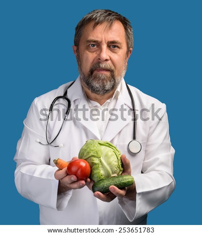 Health food concept. Doctor holding vegetables for healthy eating and healthy lifestyle