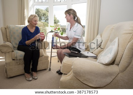 Health visitor with a patient on a home visit giving advice on prescription drugs