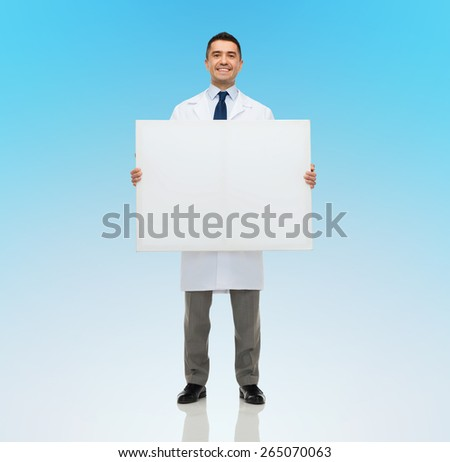 healthcare, advertisement, people and medicine concept - smiling male doctor or scientist in white coat holding white blank board over blue background