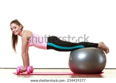 Healthy active lifestyle. Woman with gym ball and dumb bells doing exercise, isolated on white background