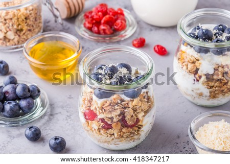 ... of oat flakes with fresh fruit, yogurt and honey, selective focus