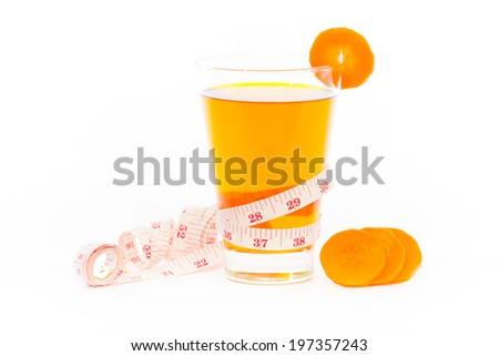 Healthy carrot juice   with tape measure on a white background.