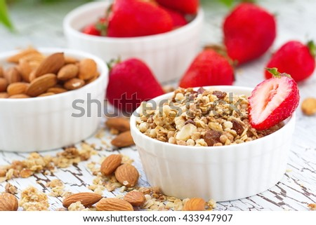 Healthy food. Oat granola with almond, chocolate and fresh strawberry.