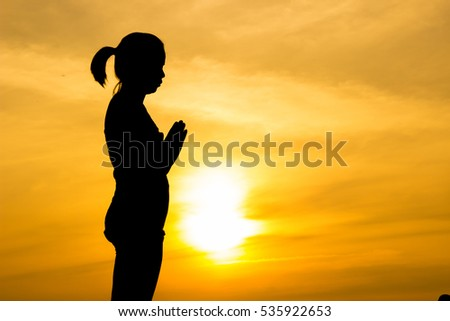 Healthy lifestyle. Silhouette meditation yoga woman amazing sunset.