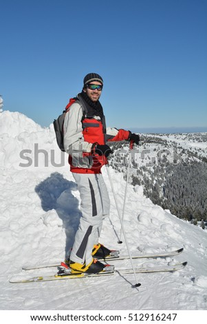 Healthy lifestyle, winter recreation, young good looking sportsman enjoying sun in cold, clear winter day, Mt.Kopaonik, Serbia