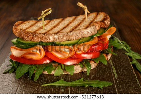 Healthy Whole Wheat Bread Sandwich with Cucumbers, Tomatoes, Lettuce and Ham