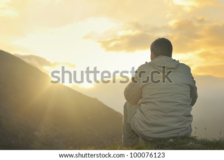 Healthy Young Man Practice Youga Height Stock Photo - This man hikes up the transylvanian mountains every morning to photograph sunrise
