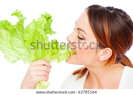 healthy young woman eating green lettuce over white background
