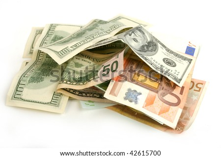 Heap of crumpled dollar and euro bills on white  background