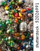 Heap of glass bead accessories. Homemade jewelry - stock photo