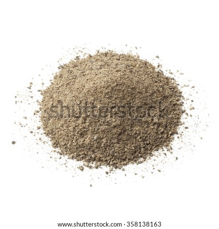 Heap of ground black pepper on white background