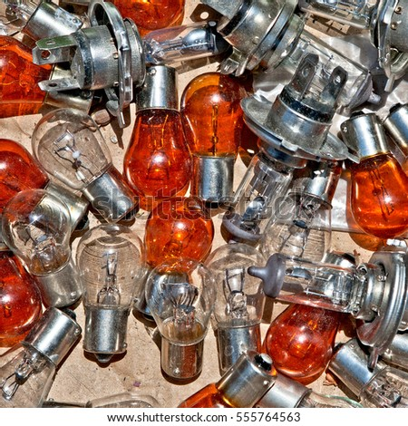 Heap of old abandoned orange and transparent radio - bulbs for retro radio and  television receivers. Useful for background