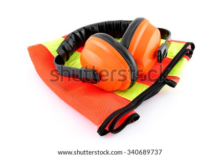 Hearing protection ear muffs on reflective safety vest on white background