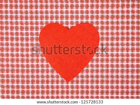 Heart from paper on a red checkered background. Valentine's Day background