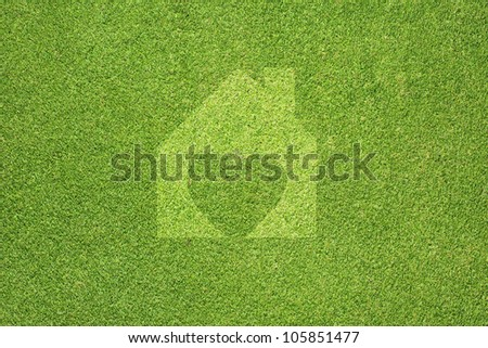 Heart of home on green grass texture and  background