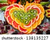 Heart shape fruit arrangement - stock photo