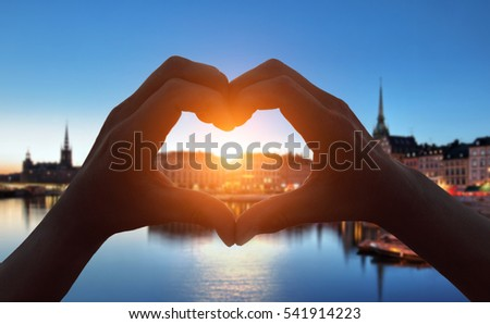 heart shape hand  in Stockholm city at night