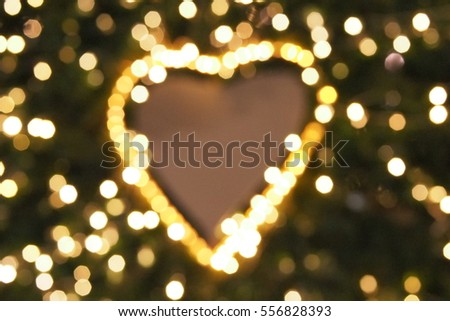 Heart shaped bokeh with blurred circle bokeh background