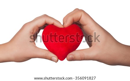 Heart symbol in woman hands isolated on white background