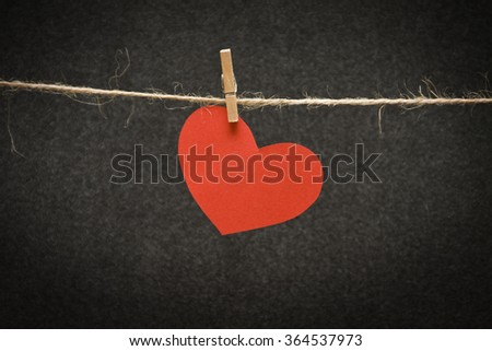 heart  to a rope with clothespin