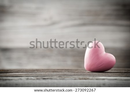 Hearton the wooden background. Valentines day greeting card.