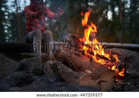 Heat by fire camp in forest
