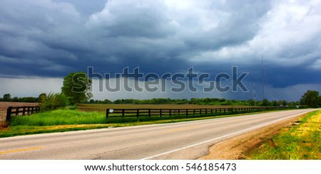 Heavy spring rains sweep over agricultural fields outside the village of Cherry Valley Illinois