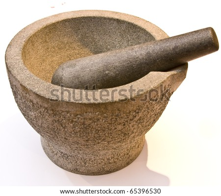 Heavy stone pestle and mortar over a white background