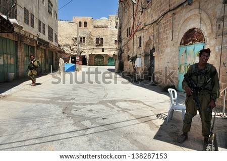 HEBRON, ISRAEL - SEP 08:Israeli soldiers gourds on the Jewish quarter of Hebron on September 09 2009.Hebron is the site of the oldest Jewish community in the world, which dates back to Biblical times.