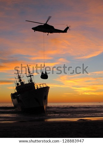 helicopter drops supplies to ship run aground