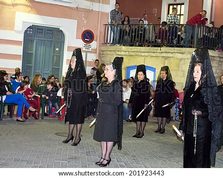 HELLIN, SPAIN - APR 18 : Night Easter procession, known as the burial procession of Christ on April 18, 2014 in Hellin, albacete province, Spain.