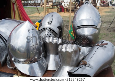 helmets and pieces of medieval armor on display