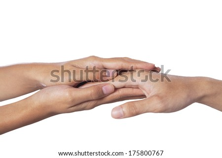 Help concept: Two people holding hands for comfort