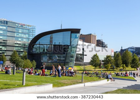 HELSINKI, FINLAND - 20 AUG 2015. People relaxing in city park at sunny summer day