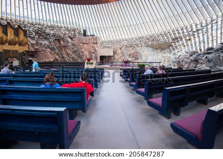 HELSINKI, FINLAND - JUNE 8, 2014: Interior of the Temppeliaukio Church on June 8, 2014 in Helsinki, Finland. It is carved in the rock and it is one of the most popular tourist attractions.
