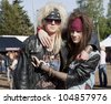 HELSINKI, FINLAND - JUNE  7: Unidentified Fans at gig of swedish hard rock band Hardcore Superstar June 7, 2012 at Rockin' Hellsinki vol 1 in Kaisaniemi park, in Helsinki, Finland. - stock photo