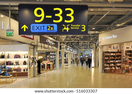 HELSINKI, FINLAND - NOVEMBER 16: Travelers and shops at Helsinki International Airport. November 16, 2015 Helsinki, Finland