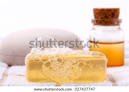 Herbal spa soap bar on white bath towel with honey isolate on white background.