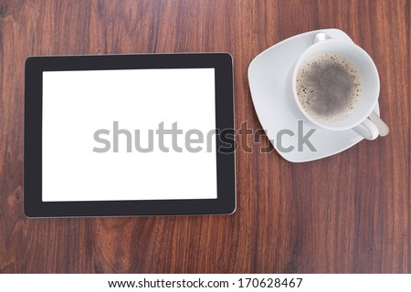 High Angle Of Digital Tablet And Coffee On Table
