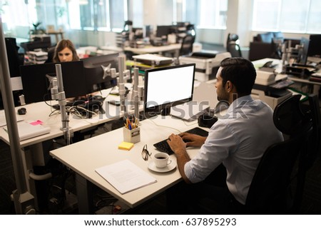 wide angle view busy design office. high angle view of businessman and businesswoman working in office wide busy design