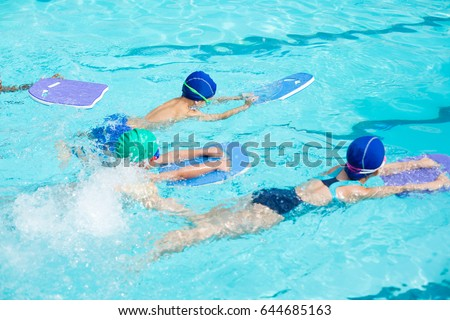 High Angle View Of Little Swimmers With Kickboards Swimming In Pool Part 76
