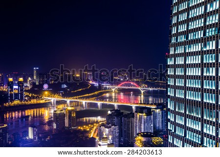 High angle view of modern skyline at night