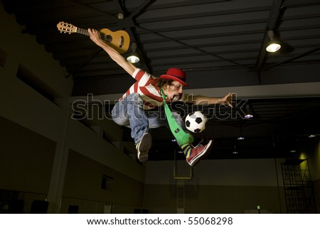 high flying crazy soccer fan with soccer ball