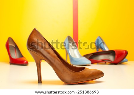 high heels shoes on colored background