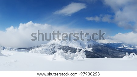 High mountains and snow plains. Winter composition