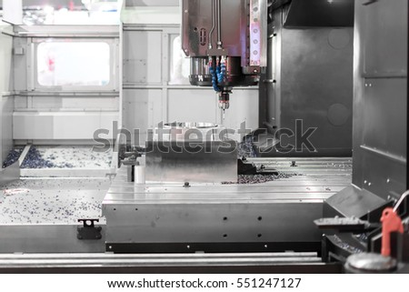 High precision CNC machining center working, operator machining die metal mold process in factory